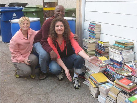 Smiles from SCEP volunteer book packers - Jane, Mensah & Kristen.