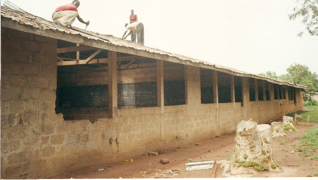 Old roofing being removed.