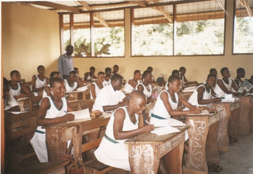 STUDENTS OF SAMPA RC JUNIOR HIGH SCHOOL FORM TWO 'A' IN CLASS AFTER THE RENOVATION OF THEIR BLOCK.